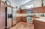 Kitchen includes all stainless steel appliances.