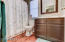 Hall bathroom is spotless and meticulously maintained.