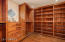 master closet with knotty Alder cabinetry