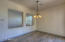 Elegant dining area is open to the Kitchen and Great Room areas and provides exterior access to back patio.
