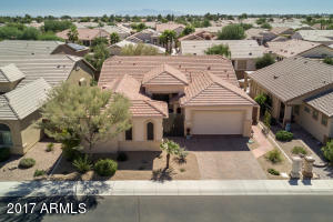 Presenting one of the most popular floor plans in the 55+ guard-gated resort of Arizona Traditions! This 2213sf Papago has the highly desired additional third car garage!