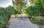 Pavers provide additional seating space and are surrounded by lush foliage