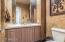 Powder Room WITH TEXAS SHELL STONE COUNTER