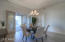 "The dining room is well located between the kitchen and the from covered patio. Note the double French doors which help to ""bring the outdoors inside."" This ability enhances the Arizona lifestyle- especially in this Desert Foothills area."