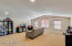 Enormous loft area makes the perfect, kids living space, guest quarters, craft room, home gym or theater. Can convert to 4th bedroom.