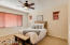 Spacious master bedroom with ceiling fan, split from the other two bedrooms and office.