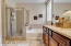 Master bathroom is gorgeous with quartz counters and shower and bath surround, garden tub, upgraded maple cabinets, walk-in closet.