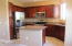Lots of cabinetry and light in this updated kitchen with granite