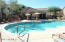 View from pool to Fitness Room with plenty of umbrella and chaise seating