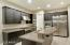 Upgraded kitchen with stainless steel appliances & quartz counter tops.