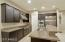 Kitchen with upgraded Jenn Air applicances & quartz counter tops.