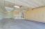 Tandem 3-car garage with custom storage cabinets and overhead storage racks.
