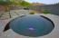 Custom 12-person negative edge heated spa with mountain views.
