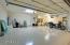 3 car garage, epoxy, cabinets, exit to yard