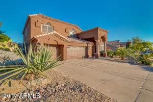 Front View with Beautiful Desert Landscaping