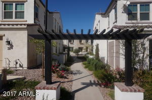 Back view of home, beautiful pathway to front entrance.