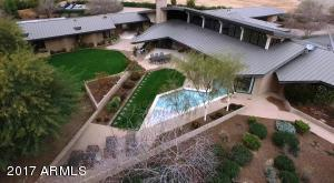 Private 2.5 acre estate with 6 bedrooms, 6 baths, including attached guest home with private entrance, 2 bedrooms , 2 baths, full kitchen, laundry, living room.