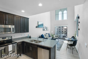 Great Room with 19' ceiling - Photos from another completed model home