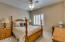 Spacious guest rooms with plantation shutters
