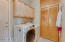 Huge laundry off the kitchen with wonderful storage.