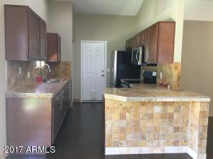 Natural Stone counters and backsplash. Brand New Stainless Appliances!
