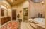 Beautiful jetted tup with rounded tile ceiling and