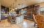 Gourmet Kitchen with professional grade appliances, granite tops, custom tile accents, walk in pantry
