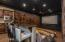 """Host a private movie screening in this professional theater with custom seating, 155"""" screen and concession area"""
