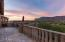 One of five outdoor terraces with cantera balustrades travertine pavers and panoramic mountain views.