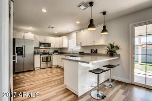 Ikea cabinets and quartz countertops in the newly remodeled kitchen!