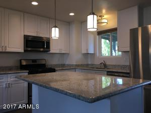 Custom Kitchen with soft close cabinets, SS Appliances and granite counters. Modern Porcelain tile throughout the home.