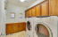 Large laundry room with ample cabinet space and sink. Washer & dryer included in sale.