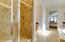 Walk-in shower & 3 vanities in spacious master bathroom