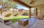 Easy to maintain backyard and large covered patio with in-ceiling speakers.