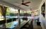 The covered patio extends the length of the house!