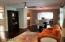 Spacious living/dining room with hardwood flooring.