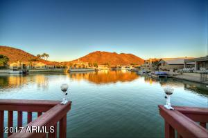 Imagine relaxing in your backyard with private dock, enjoying this amazing view.