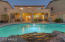 Backyard with extensive covered patio & heated salt water pool