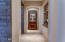 Hallway view with Cantera stone entry into Formal Dining room to the left