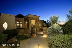 Meander down pavered walkway into your gated courtyard featuring a pond with relaxing waterfall & luxurious landscaping.