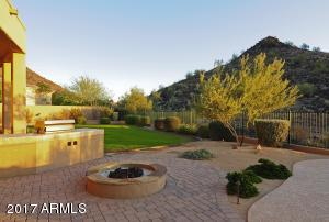 2+ acre North/South facing lot backs to (and includes) little Saddleback Mountain. Grassy play area, firepit, outdoor kitchen, huge patio & luxurious pool & spa complete this outdoor resort space.