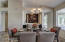 Spacious dining and entertaining area with windows and view to gorgeous resort style pool.
