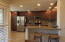 """Kitchen View showing granite and 36"""" cabinets with crown molding"""