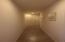 Hallway to master, utility and garage