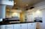 Kitchen also has pot shelves and granite