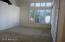 Master bedroom w/shuttered windows and door to patio & pool
