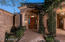 With the lush grass on the property, adjacent to the entry,