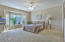 Large master bedroom with bay windows and large walk in closet