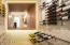 An architectural focal point of the main hallway is a 250+ climate controlled Wine Room
