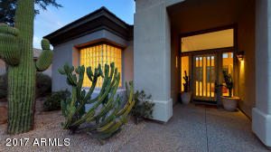 Large Saguaro cactus greets you at the entry to the home.